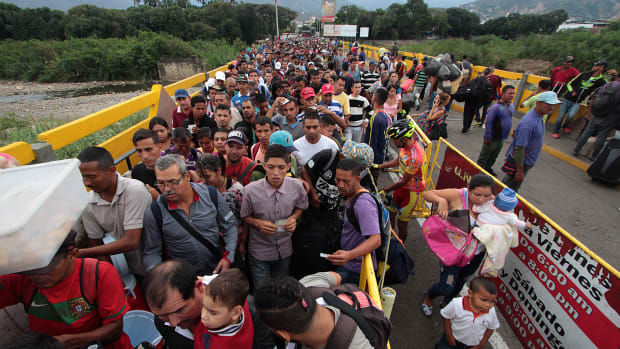 Venezuelan citizens cross the Simon Bolivar international bridge from San Antonio del Tachira in Venezuela to the Norte de Santander province of Colombia.