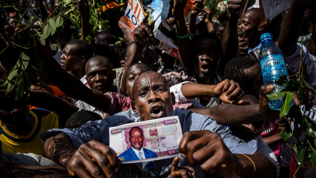 Supporters react before the Kenyan opposition National Super Alliance (NASA) coalition leader has himself sworn in as the 'people's president' on January 30th, 2018 in Nairobi. Kenyan opposition leader Raila Odinga had himself sworn in as an alternative president in front of thousands of supporters, three months after an election he claims was stolen from him.