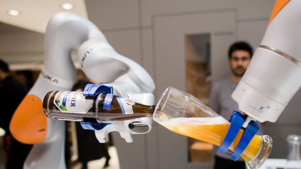 Robots from the company Kuka serve non-alcoholic beer during the Hannover Fair on April 23rd, 2018, in Hanover, Germany. The Hanover technology fair runs until April 28th, 2018, with Mexico as a partner country.