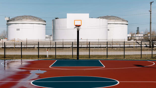 Oil storage tanks loom across the street from Tod Park in downtown East Chicago.
