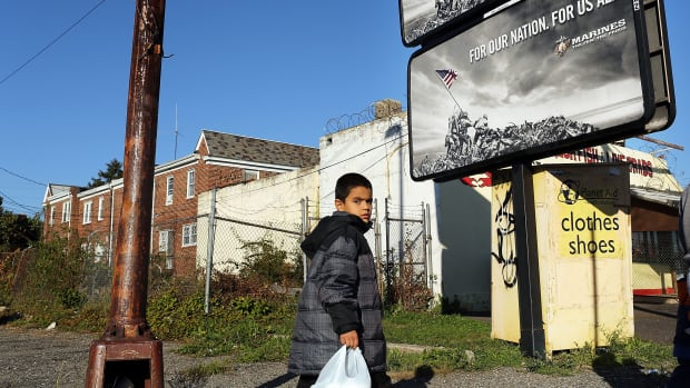 A child walks down a street in Camden, New Jersey.