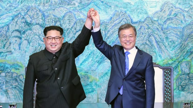 North Korean leader Kim Jong Un (L) and South Korean President Moon Jae-in (R) pose for photographs after signing the Panmunjom Declaration for Peace, Prosperity, and Unification of the Korean Peninsula during the Inter-Korean Summit at the Peace House on April 27th, 2018, in Panmunjom, South Korea. Kim and Moon met at the border for the third-ever Inter-Korean summit talks after the 1945 division of the peninsula, and first since 2007 between then President Roh Moo-hyun of South Korea and Leader Kim Jong-il of North Korea.