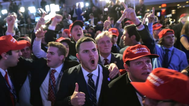 Trump supporters react to results during election night in New York City on November 8th, 2016.