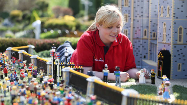Legoland employee, Lucy, poses putting a Lego model of U.S. actress Meghan Markle in place next to her husband-to-be Britain's Prince Harry outside a Lego-brick model of Windsor Castle at Legoland in Windsor on May 8th, 2018, during a photo call for its attraction celebrating the upcoming royal wedding. Prince Harry and Markle will marry on May 19th at St. George's Chapel.