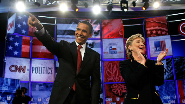 Democratic presidential hopefuls U.S. Sen. Barack Obama (D-IL) and U.S. Sen. Hillary Clinton (D-NY) wave to the audience as they participate in a debate in the Lyndon B. Johnson Auditorium at the University of Texas on February 21st, 2008 in Austin, Texas.