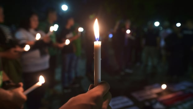Indonesian people take part in a candlelight vigil in support of the victims and their relatives following a series of bomb attacks in Surabaya, in Jakarta, on May 14th, 2018. A family of five, including a child, carried out the suicide bombing of a police headquarters in Indonesia, police said, a day after a deadly wave of attacks on churches staged by another family.