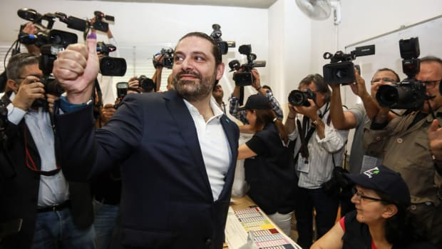 Lebanese Prime Minister Saad Hariri gives a thumbs-up to journalists after voting at a polling station in Beirut on May 6th, 2018.
