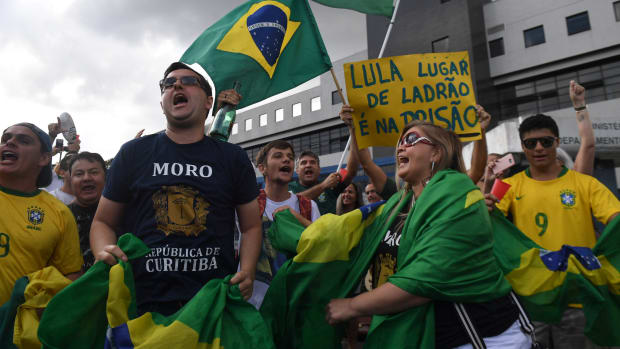 People demonstrate against former Brazilian president Luiz Inacio Lula da Silva outside the Federal Police headquarters.
