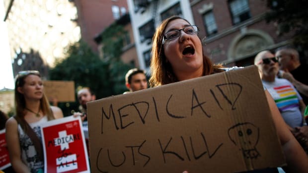 A group of activists rally against the GOP health-care plan outside on July 5th, 2017, in New York City.