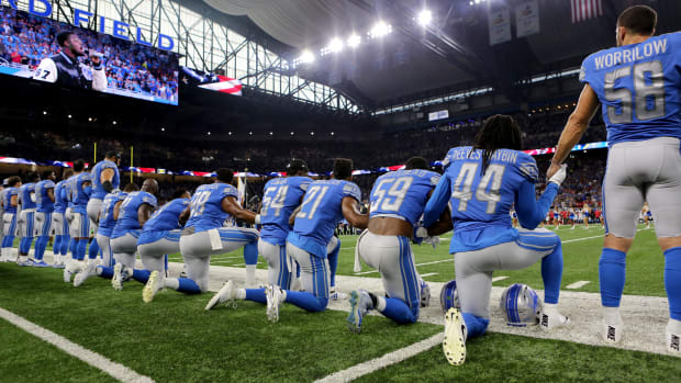 Members of the Detroit Lions take a knee during the playing of the national anthem at Ford Field on September 24th, 2017, in Detroit, Michigan.
