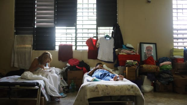 Two women rest in a shelter for Hurricane Maria victims in in Toa Baja, Puerto Rico, on December 25th, 2017.