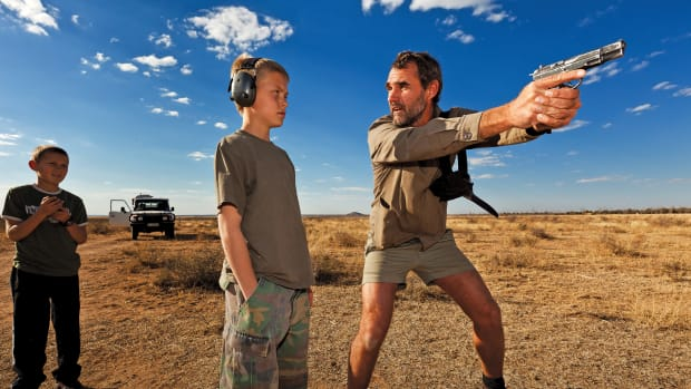 Orania, South Africa: Niklas Kirsten, a former paratrooper in the South African Army, instructs Erik Du Pree on handgun self-defense in the fields outside an ultra-conservative, all-Afrikaner stronghold known as Orania.