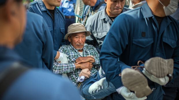 A protester is removed by police officers during a sit-in to block construction vehicles working on the expansion of Camp Schwab, a United States military base, on May 31st, 2018, in Nago, Okinawa prefecture, Japan. Demonstrators protesting against the U.S. military presence on the southern Japanese island of Okinawa have staged continuous protests outside Camp Schwab to block construction vehicles as the camp is expanded to accommodate the relocation of an airbase in nearby Henoko.