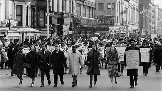 Civil rights advocates march in the Harlem section of New York to protest racial violence in Alabama on March 16th, 1965.