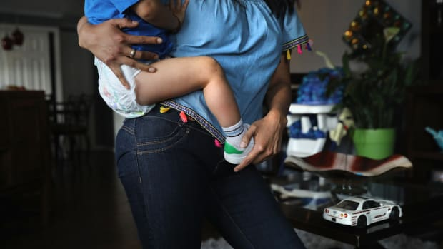 An undocumented immigrant from Peru holds her son at their home on June 6th, 2017, in Thornton, Colorado.