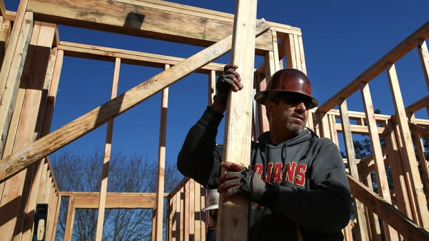 A worker carries lumber as he builds a new home on January 21st, 2015, in Petaluma, California.