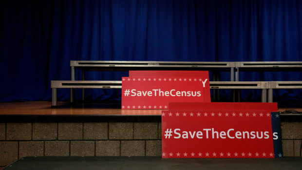 Signs sit behind the podium before the start of a press conference with New York Attorney General Eric Schneiderman to announce a multi-state lawsuit to block the Trump administration from adding a question about citizenship to the 2020 Census form on April 3rd, 2018, in New York City.
