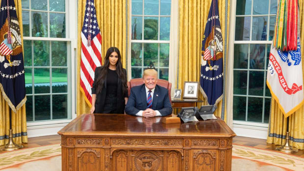 Kim Kardashian poses with President Donald Trump at the White House.