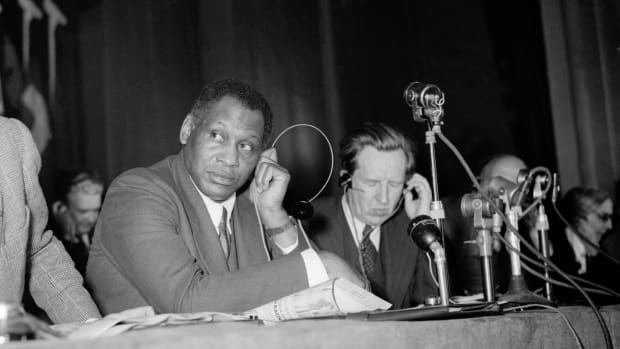 Paul Robeson listens to a speech during the Peace Partisans World Congress in Moscow on April 20th, 1949. Robeson lost his passport in 1950.