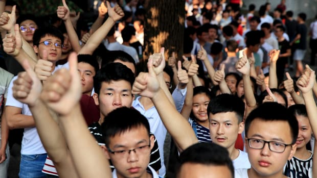 Candidates cheer for themselves before sitting the National College Entrance Examination (a.k.a. Gaokao) outside an exam site on June 7th, 2018, in Luzhou, Sichuan Province of China. About 9.75 million Chinese high school students will take the 2018 National College Entrance Examination.