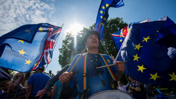 A man bangs a drum as anti-Brexit demonstrators gather outside the Houses of Parliament on June 11th, 2018, in London, England. The European Union withdrawal bill returned to the House of Commons for the first of two sessions in which members of parliament will consider amendments imposed by the Lords, and another set of fresh amendments.