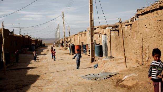 Afghan children wander at the Shahid Nasseri refugee camp in Taraz Nahid, near the city of Saveh, some 130 kilometers southwest of the capital of Tehran, Iran.