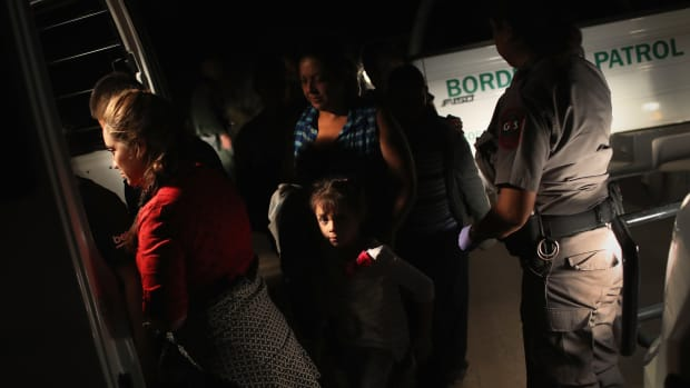 U.S. Border Patrol agents detain a group of Central American asylum seekers near the U.S.-Mexico border on June 12th, 2018 in McAllen, Texas.