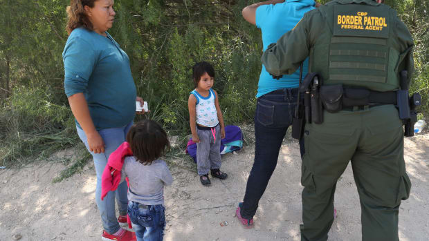 U.S. Border Patrol agents take Central American asylum seekers into custody on June 12th, 2018, near McAllen, Texas.