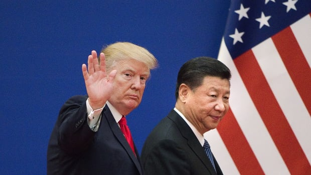 Donald Trump (L) and China's President Xi Jinping leave a business leaders event at the Great Hall of the People in Beijing.