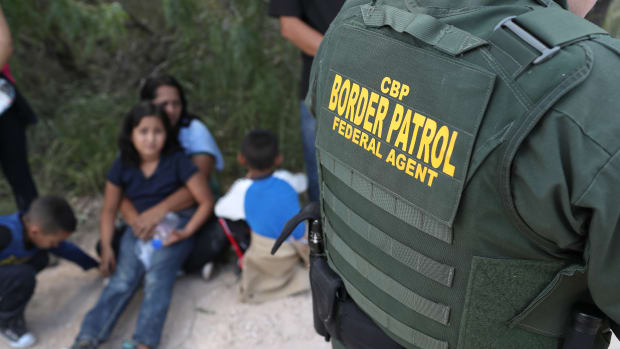 Central American asylum seekers wait as U.S. Border Patrol agents take them into custody on June 12th, 2018, near McAllen, Texas.