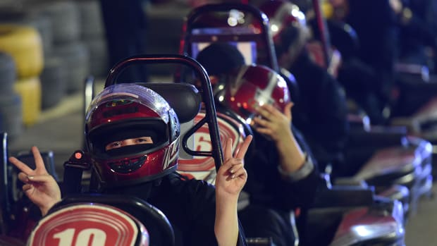 A Saudi woman poses for the camera as she uses a go-cart during a driving workshop for women in the Saudi capital of Riyadh on June 21st, 2018. Saudi Arabia will allow women to drive from June 24th, ending the world's only ban on female motorists, a historic reform marred by what rights groups call an expanding crackdown on activists.