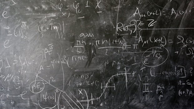 A detailed view of the blackboard with theoretical physics equations in chalk by Alberto Ramos.