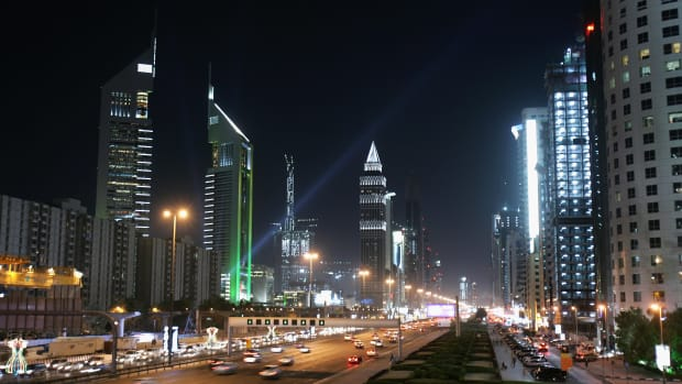 The iconic Emirates Towers dominate the skyline beside the wide boulevard of Sheikh Zayed Road on December 3rd, 2007, in Dubai, United Arab Emirates.