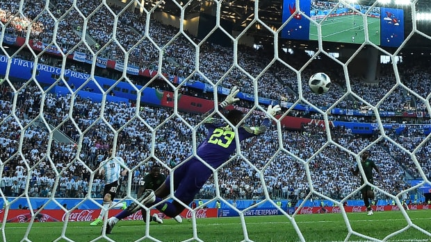 Argentina's forward Lionel Messi (L) shoots to score during the Russia 2018 World Cup Group D football match between Nigeria and Argentina at the Saint Petersburg Stadium in Saint Petersburg on June 26th, 2018. Argentina ultimately beat Nigeria 2–1, advancing to the round of 16.