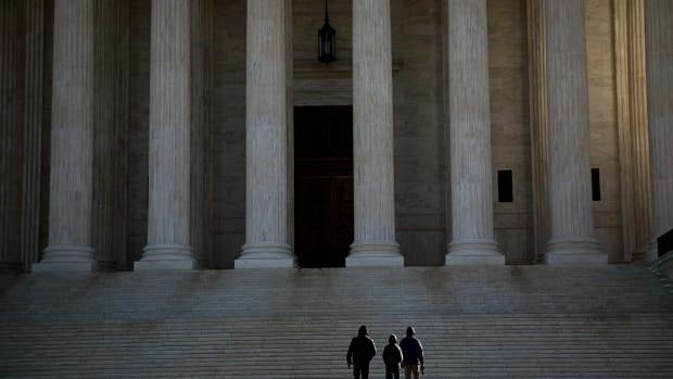 Visitors walk outside the Supreme Court.