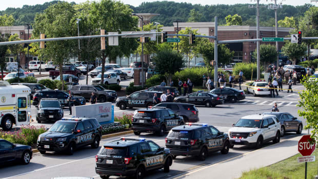 "Police respond to a shooting on June 28th, 2018, in Annapolis, Maryland. At least five people were killed Thursday when a gunman opened fire inside the offices of the Capital Gazette, a newspaper published in Annapolis, a historic city an hour east of Washington. A reporter for the daily, Phil Davis, tweeted that a ""gunman shot through the glass door to the office and opened fire on multiple employees. There is nothing more terrifying than hearing multiple people get shot while you're under your desk and then hear the gunman reload."""