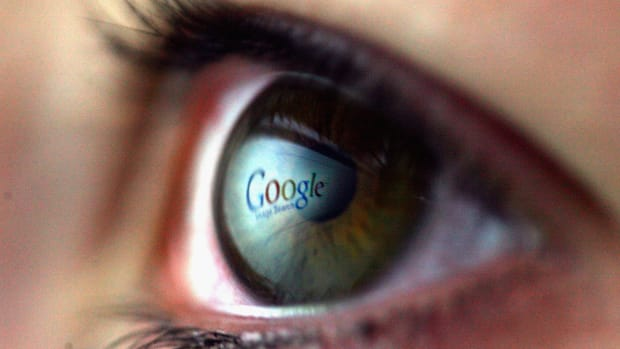 The Google logo reflected in the eye of a girl.