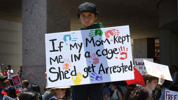 A young protester takes part in a march against the separation of immigrant families on June 30th, 2018, outside of an Immigration and Customs Enforcement detention facility in Los Angeles, California.