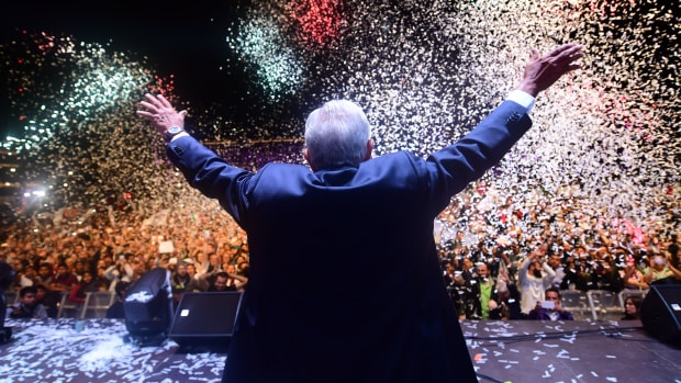 Mexico's newly elected President Andres Manuel Lopez Obrador, representing the Juntos Haremos Historia Party, cheers his supporters at the Zocalo Square after winning general elections, in Mexico City, on July 1st, 2018.