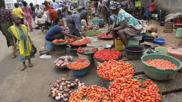 Vendors display tomatoes and pepper at Mile 12 market in Lagos, Nigeria.