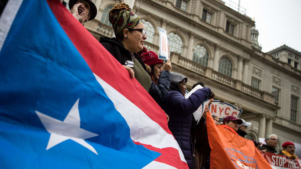 Activists rally in support of Puerto Rican families displaced by Hurricane Maria, on the steps of City Hall, April 19th, 2018 in New York City.