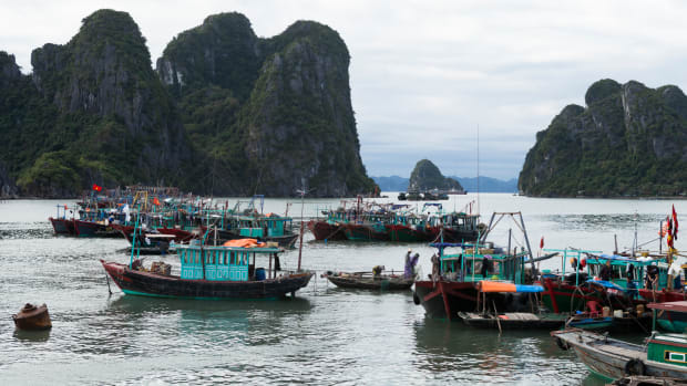 Business as usual for fishermen on the morning after Typhoon Haiyan made landfall on November 12th, 2013, in Halong City, Vietnam.