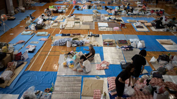 People affected by the recent flooding rest at a makeshift shelter in Mabi, Okayama prefecture, Japan, on July 11th, 2018.