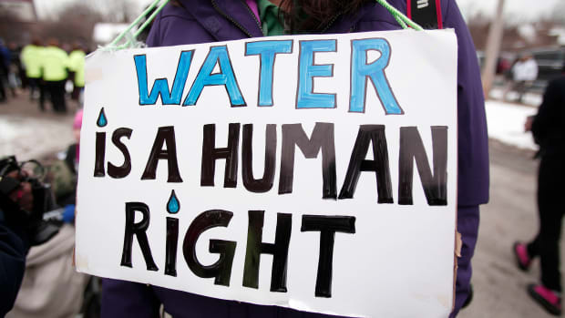Activists gathering for a mile-long march to highlight the push for clean water on February 19th, 2016, in Flint, Michigan.