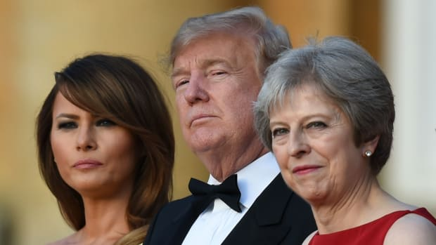 U.S. First Lady Melania Trump, President Donald Trump, and Britain's Prime Minister Theresa May stand on the steps in the Great Court on the first day of Trump's visit to the United Kingdom.