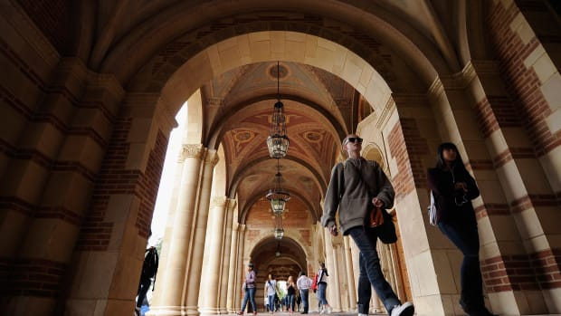 Students walk near Royce Hall on the University of California–Los Angeles campus in Los Angeles, California.