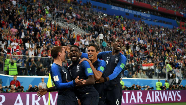 Samuel Umtiti of France celebrates with teammates after scoring his team's first goal during the 2018 FIFA World Cup Russia semi-final match between Belgium and France.