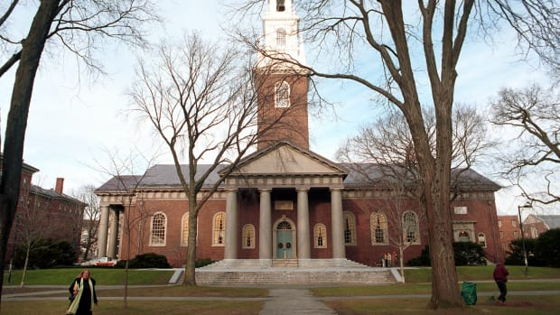 People walk around Harvard University's main campus.