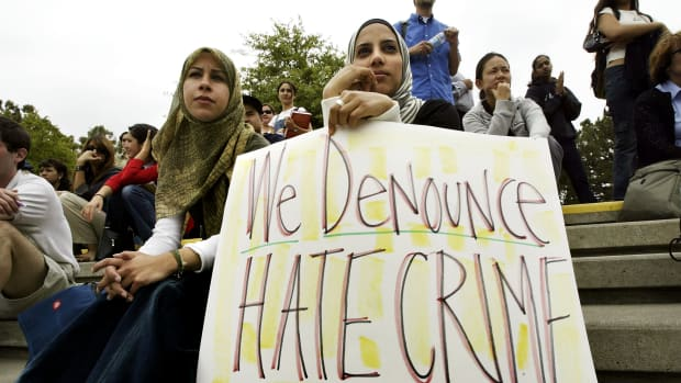 Zeena Sabri (left) and Rima Karuf join members of the Society of Arab Students at the University of California–Irvine to protest the destruction of a cardboard wall that was supposed to portray the security wall built to keep Palestinian suicide bombers out of Israel on May 27th, 2004, in Irvine, California.