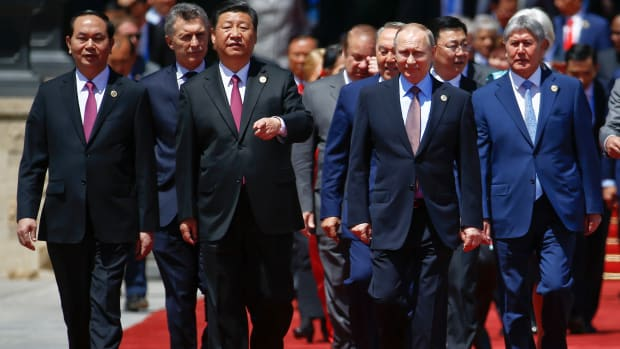 Chinese President Xi Jinping and Russian President Vladimir Putin arrive with other leaders for a family photo during the Belt and Road Forum.